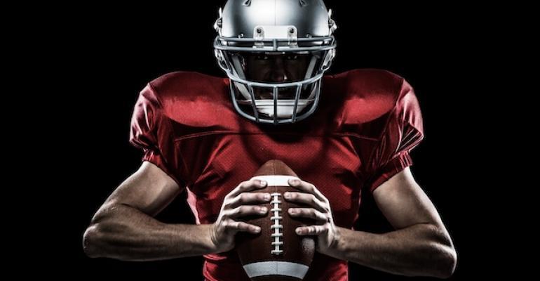 football player holding a ball